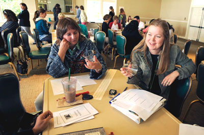 teachers hold discussion over table